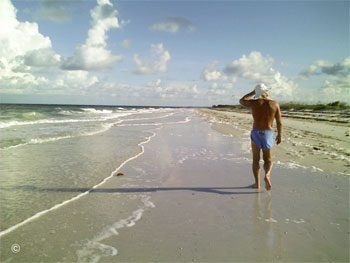 """It's like a 'walking prayer' in a 360 degree open air cathedral…"" Hal walking on a pristine barrier island beach along the Gulf of Mexico.   Photo by B.J. Stowers ©2008"